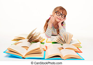 Little girl sitting on floor with a lot of books - Satisfied...