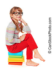 Little girl sitting on floor with a lot of books - Little...