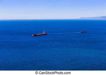 Container cargo ship and vessels in ocean