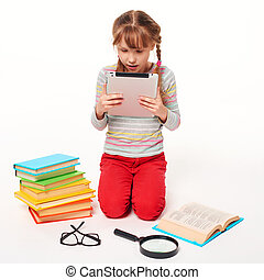 Girl with a lot of books reading digital tablet - New...