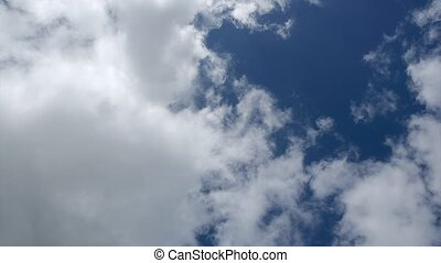 Big white clouds in blue sky - timelapse of cumulus - Full...