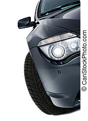 Shining headlight of a modern black car