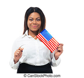 Smiling african busiensswoman holding US flag isolated on a...