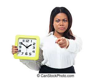 Businesswoman holding clock and pointing at camera - Angry...