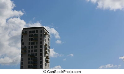 Highrise and clouds time lapse - Time lapse recording of a...