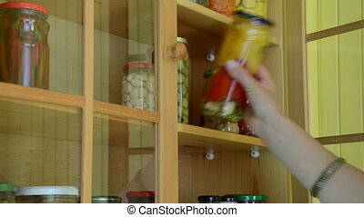 hand take glass pot food - Girl hand put canned pickled...