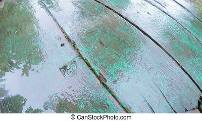 Rain on wooden table