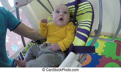 baby swing at home - Father man put newborn baby boy or girl...