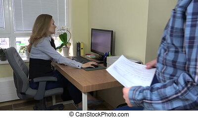 man and office girl paper - new employee man need help for...