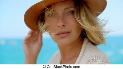 Blond Woman Wearing Hat by Breezy Ocean - Extreme Close Up...