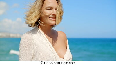 Blond Woman Admiring View of Ocean - Head and Shoulders of...