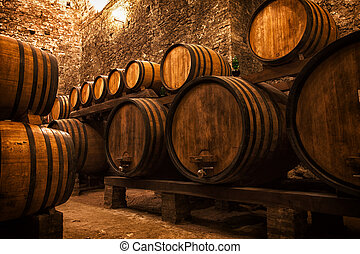 cellar with barrels for storage of wine, Italy