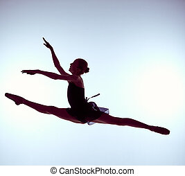 Beautiful young ballet dancer jumping on a gray background -...
