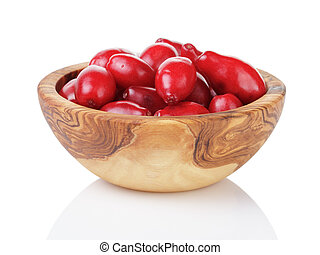 fresh bogwood berries in wood bowl isolated on white...