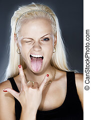 rock-n-roll - close up portrait of cool blonde showing...
