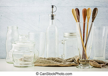 Collection of kitchenware on white wooden background
