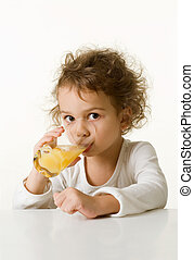 little girl drinking orange juice - Caucasian little girl,...