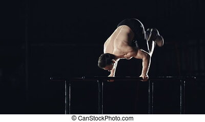 Parallel Bar Dip to Handstand to Pl - Side view of...