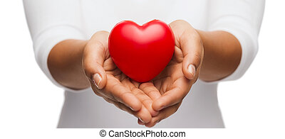 womans cupped hands showing red heart - people, relationship...