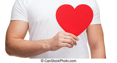 closeup of man hands with heart - relationships and love...