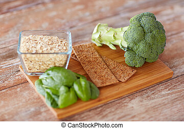 close up of food rich in fiber on wooden table - healthy...