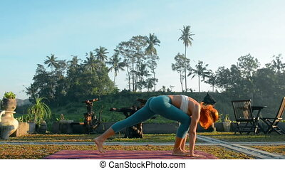 Sun salutation sequence - Young woman performing sun...