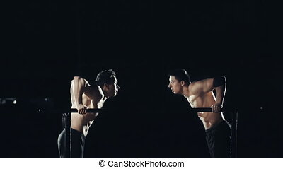Parallel Bars Muscle Ups - Two sportsmen doing parallel bars...