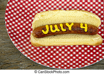July 4th hot dog on a bun - Hot dog with mustard on a bun...
