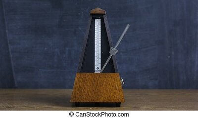 Metronome clicking on a table - Classic metronome clicking...