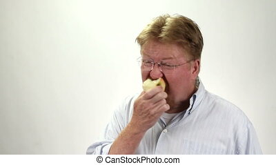 Man Eating Apple Funny - Man stuffs his mouth while eating...