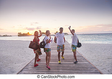 group of friends on beautiful beach