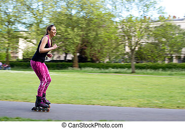 roller skating - panning shot of a woman on rollerblades