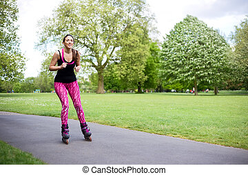 roller skating - young woman skating in the park