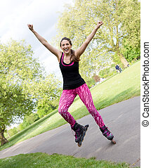 roller skating - happy young woman with rollerblades in the...