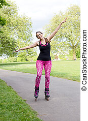 roller skating - happy woman in her rollerblades