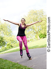 roller skating - happy woman balancing in her rollerblades