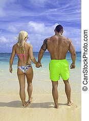 fit couple at the beach in hawaii