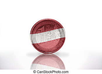 euro coin with latvian flag on the white background