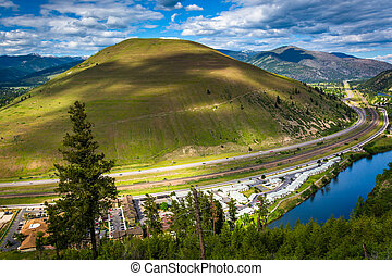 View of a large hill and the Clark Fork River, in Missoula,...