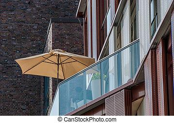 Beach umbrella on an apartment patio - Sunshade or beach...