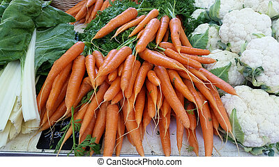 Fresh organic carrots at the local market : Lyon, France - A...