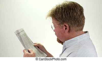 Man Reading Stock Market Report - Mature man reads and check...