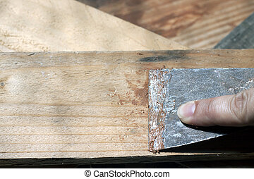 putty knife - a woman using a putty nkife so as to refurbish...