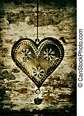 heart - gold metal heart on vintage background