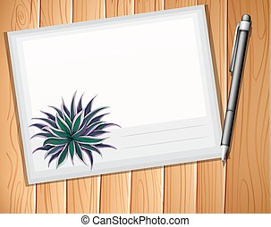 Envelop with a pen on plank background