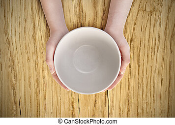 Empty plate in hand - Hunger concept. Female holding empty...