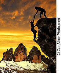 girls climbing on the rock - Silhouette of girls climbing on...