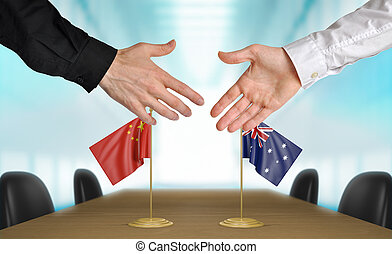 China and Australia diplomats agreeing on a deal.