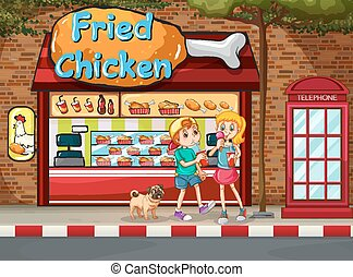 Fried chicken shop - Children eating junkfood in front of...
