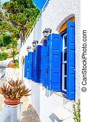 Iconic blue wooden shutters in Greece - Iconic blue wooden...